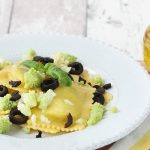 Gluten-free ricotta and spinach Raviolini with Romanesco broccoli and olives