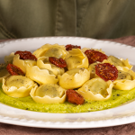 Tortellini filled Ricotta and Spinach with avocado cream and cherry tomatoes confit